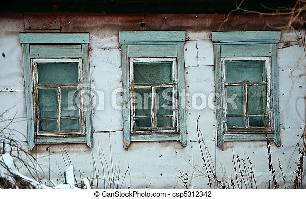 Old rustic wall with a window. Fragment, close-up. Rural life. - csp5312342