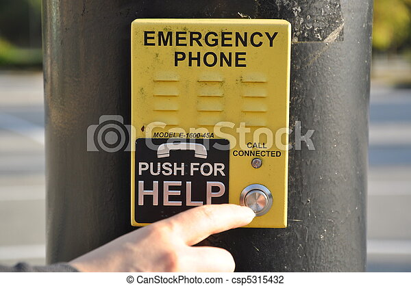 Pushing emergency phone for help - csp5315432