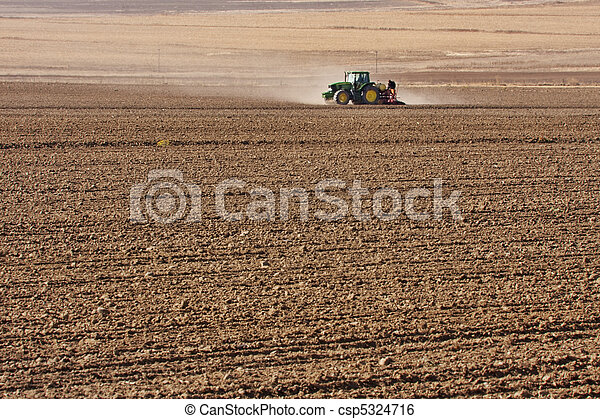 tractor planting wheat - csp5324716