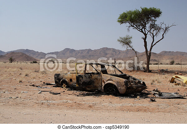 Car wreck by the side of the road in the desert in Namibia - csp5349190