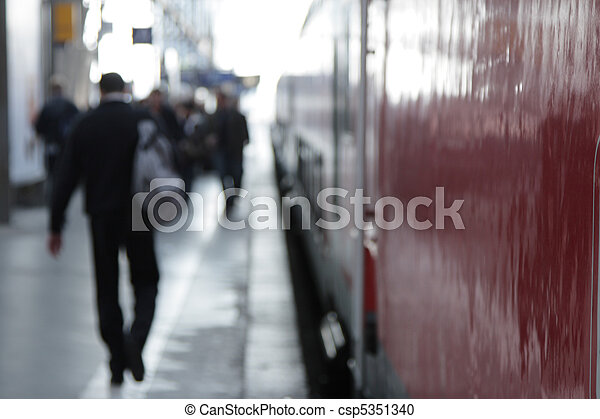 Travelers on a railway platform, focus on the foreground. - csp5351340
