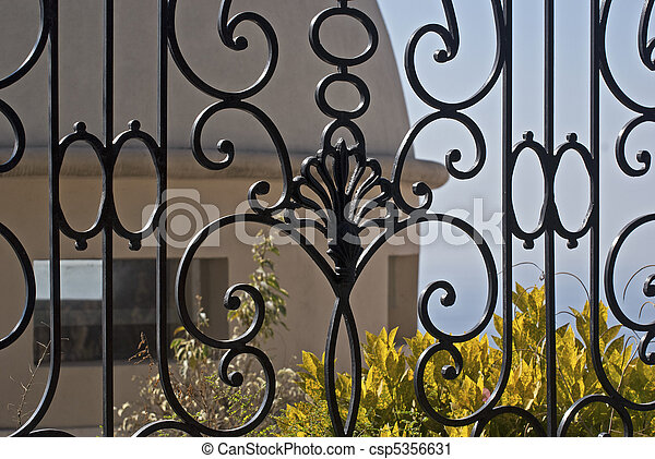 Wrought iron fence in foreground - csp5356631