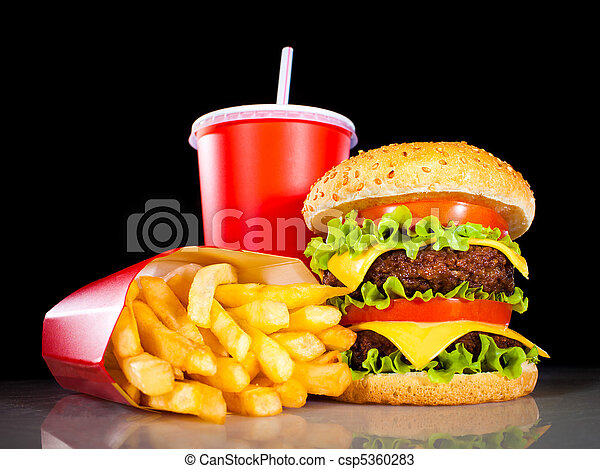 Tasty hamburger and french fries on a dark - csp5360283