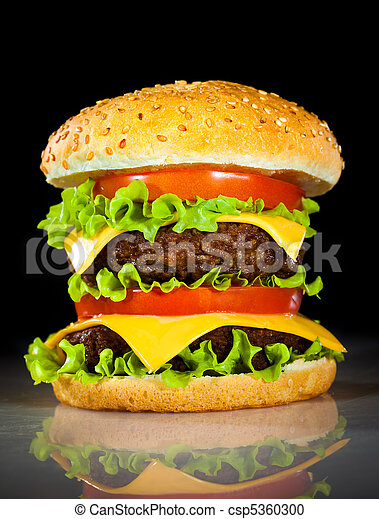 Tasty and appetizing hamburger on a dark - csp5360300