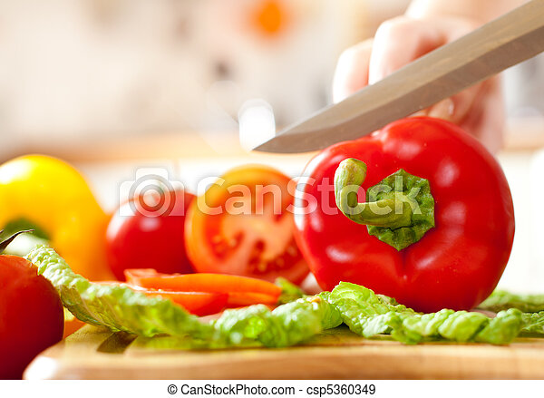 Woman's hands cutting vegetables - csp5360349