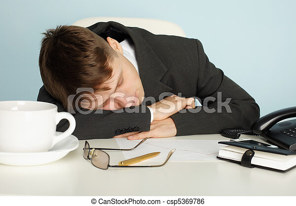 Office worker was tired and fell asleep at table - csp5369786