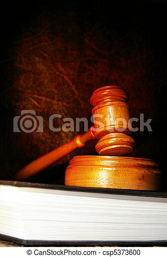 legal gavel on a law book in dramatic light - csp5373600