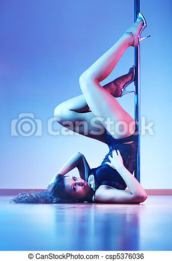 Young sexy pole dance woman - csp5376036