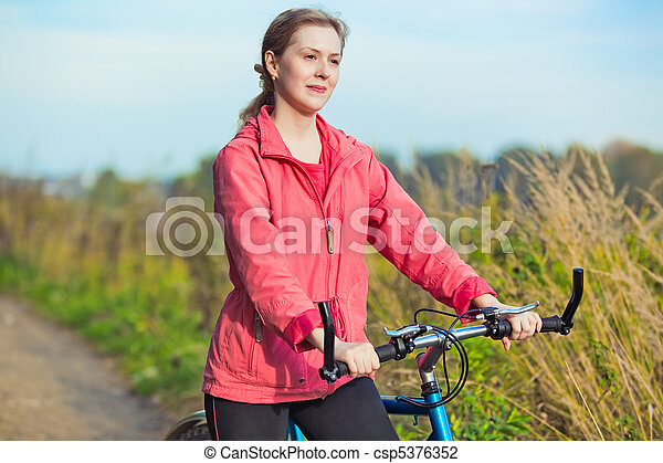 Young woman with bicycle - csp5376352