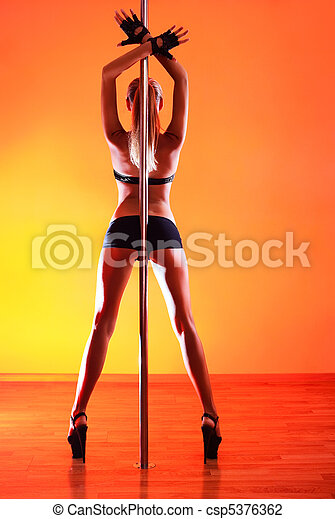 Young sexy pole dance woman - csp5376362