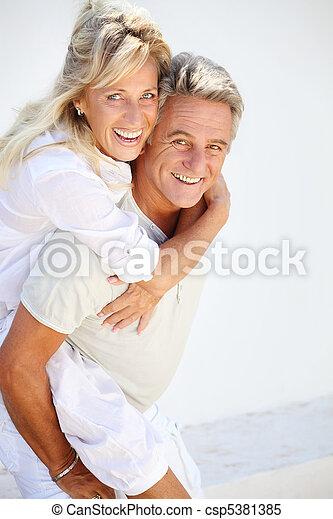 Happy mature couple - csp5381385