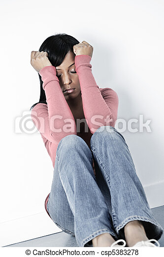 Depressed woman sitting on floor - csp5383278