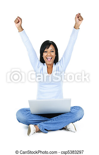 Successful young woman with computer - csp5383297