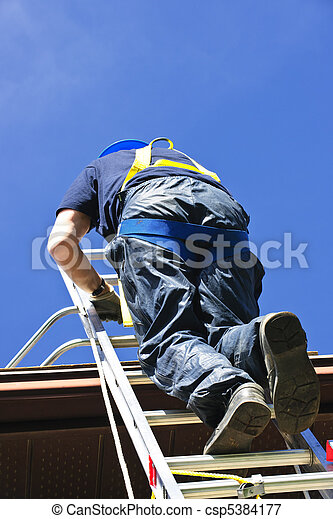 Construction worker climbing ladder - csp5384177