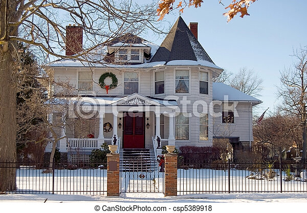 Christmas Wreaths On Victorian Home In Snow