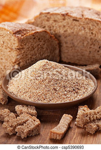 Breadcrumb with black bread - csp5390693