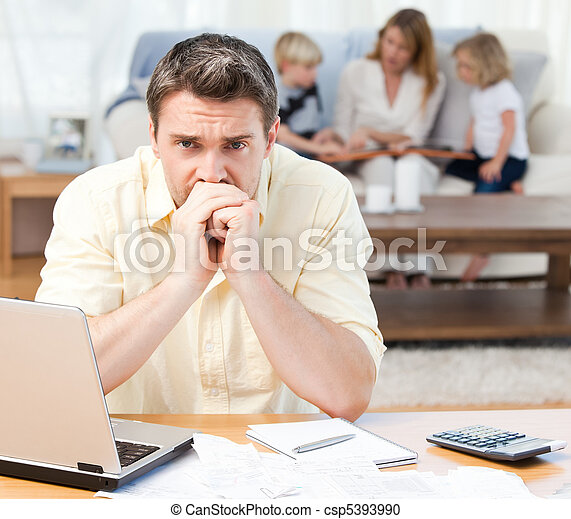 Man calculating his bills while his - csp5393990