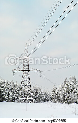High-voltage electric lines laid on the snowy evergreen northern woods in Russia - csp5397655