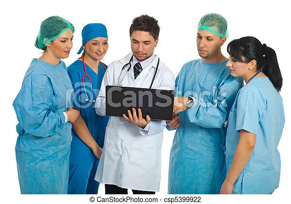 Doctors team using laptop