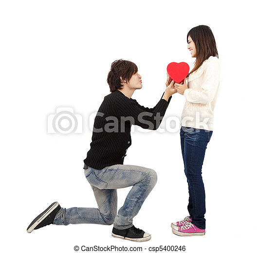 Asian young Man handing over love gift  to  young woman on Valentine Day isolated on white background   - csp5400246