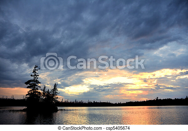 Scenic Island on a Remote Wilderness Lake with Dramatic Sky - csp5405674