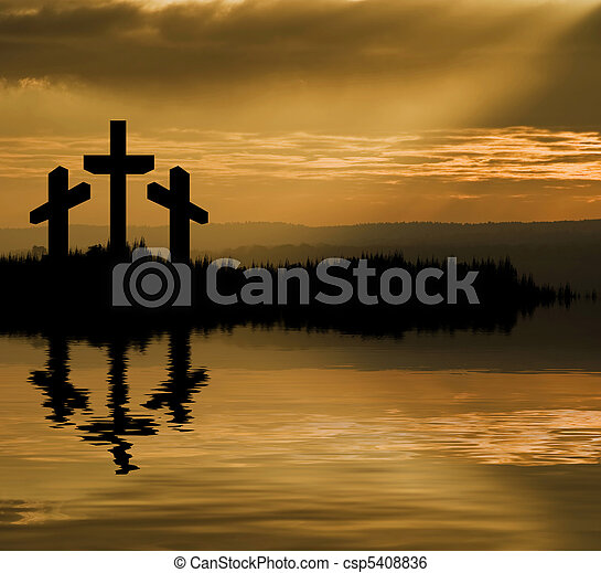 Silhouette of Jesus Christ crucifixion on cross on Good Friday Easter reflected in lake water - csp5408836