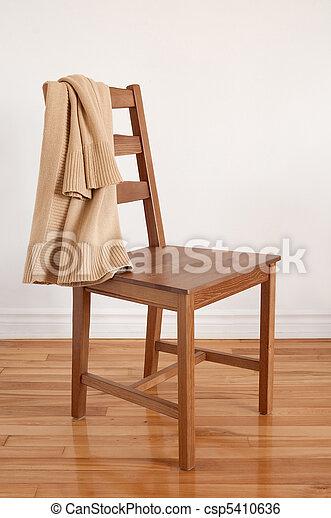 Stock de imagenes de silla de madera piso ropa puesto - Sillas de piso ...