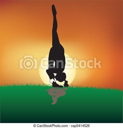Yoga poses at dusk - csp5414526
