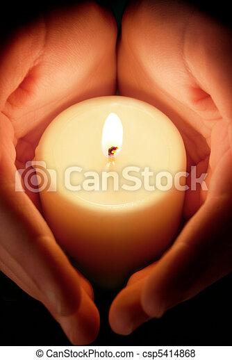 candle between the hands - csp5414868