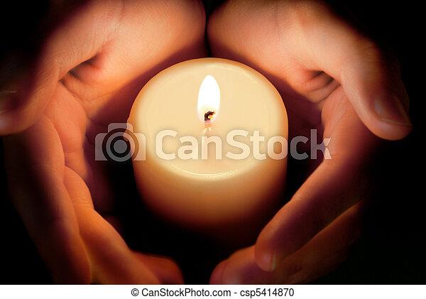 candle between the hands - csp5414870