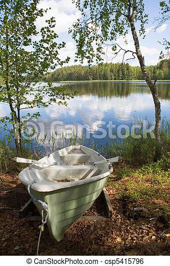 Rowboat stranded ashore - csp5415796