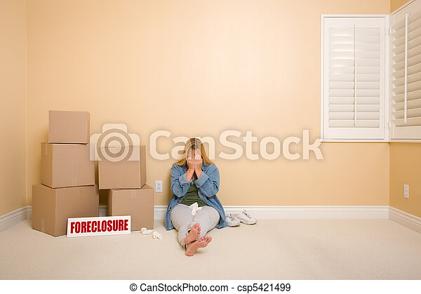 Upset Woman on Floor Next to Boxes and Foreclosure Sign - csp5421499