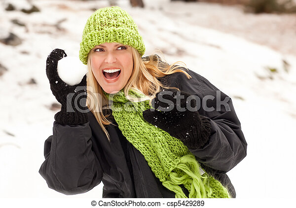 Attractive Woman Having Fun in the Snow - csp5429289