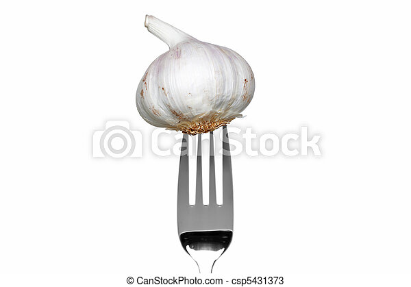 Whole garlic on a fork isolated on white - csp5431373