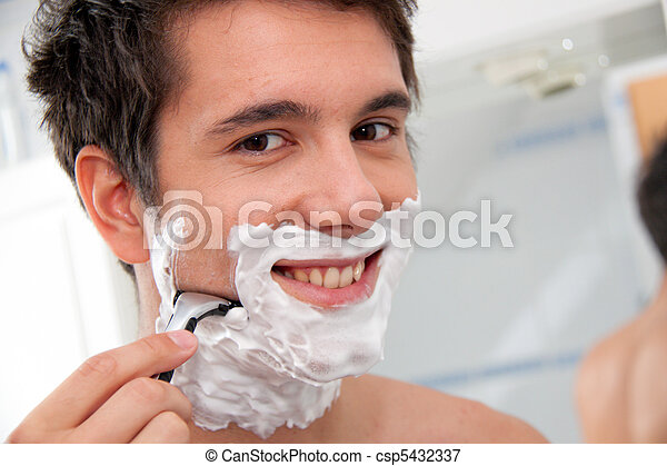 Man shaves with a razor blade And Rasierschau - csp5432337