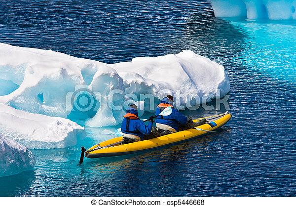 Two men in a canoe  - csp5446668
