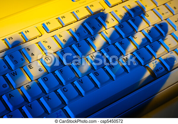 Keyboard and shadow. Data theft. - csp5450572