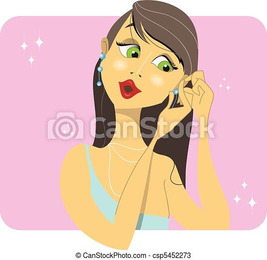 Brunette woman placing her earrings - csp5452273