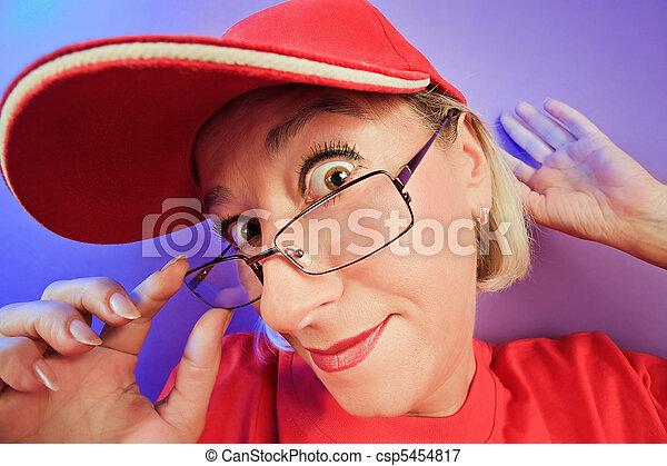 Funny surprised woman portrait on vivid color background - csp5454817