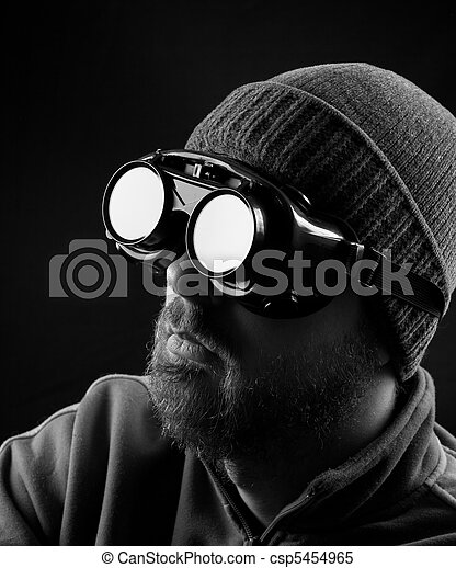Man wearing protective goggles - csp5454965