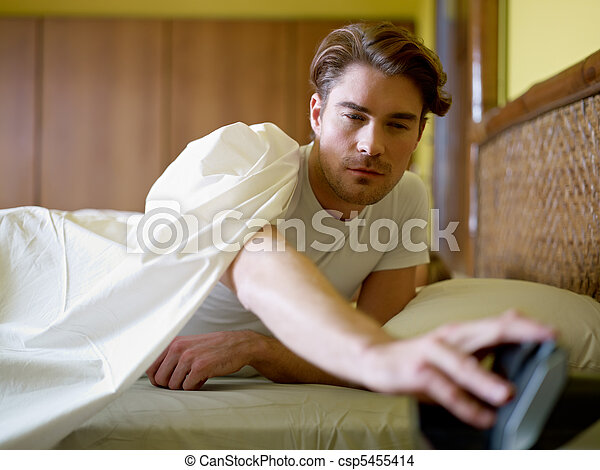 young adult man waking up in the morning - csp5455414