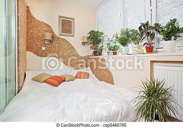 Sunny bedroom on balcony interior with Window and plants - csp5460765