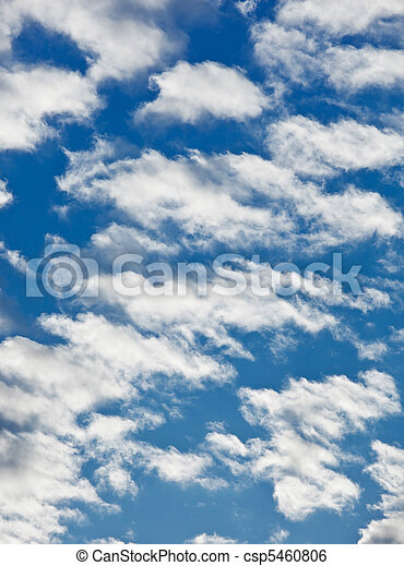 Fleecy clouds on blue sky background - csp5460806