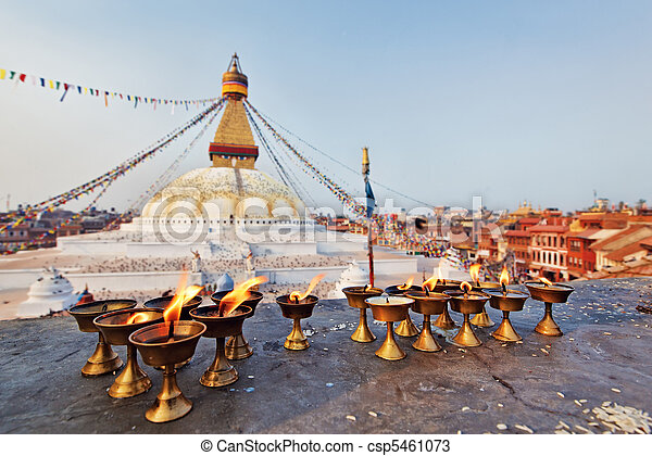 Many sacred candles in front of Boudha Nath (Bodhnath) stupa in kathmandu, Nepal - csp5461073