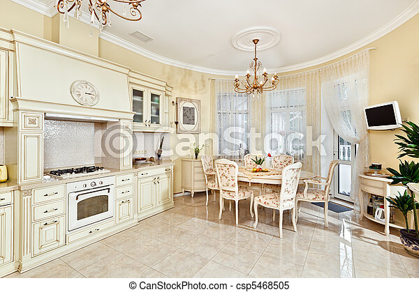 Classic style kitchen and dining room interior in beige pastoral colors - csp5468505