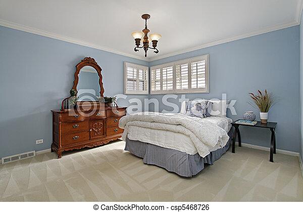 Master bedroom with light blue walls - csp5468726