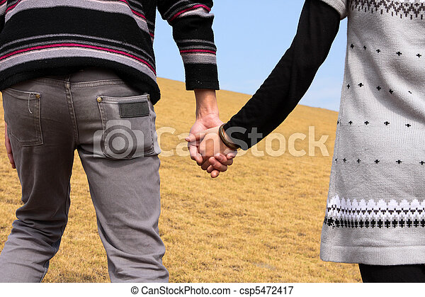 Hand-in-hand. Couple love in autumn scenery - csp5472417