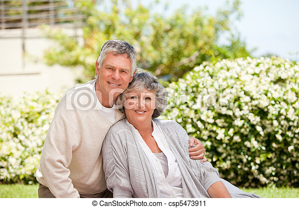 Retired couple looking at the camera - csp5473911