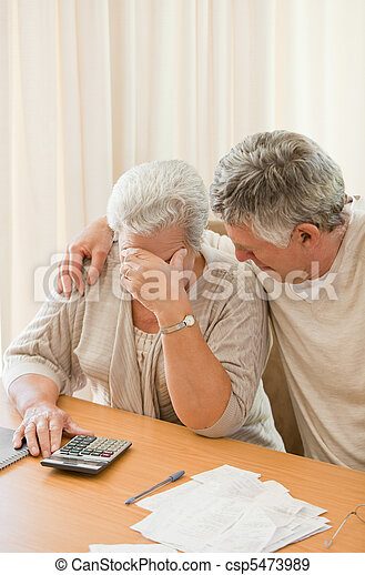 Sad mature couple calculating their domestic bills - csp5473989