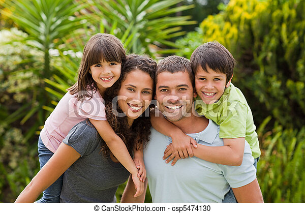 Mother and father giving children a piggyback - csp5474130